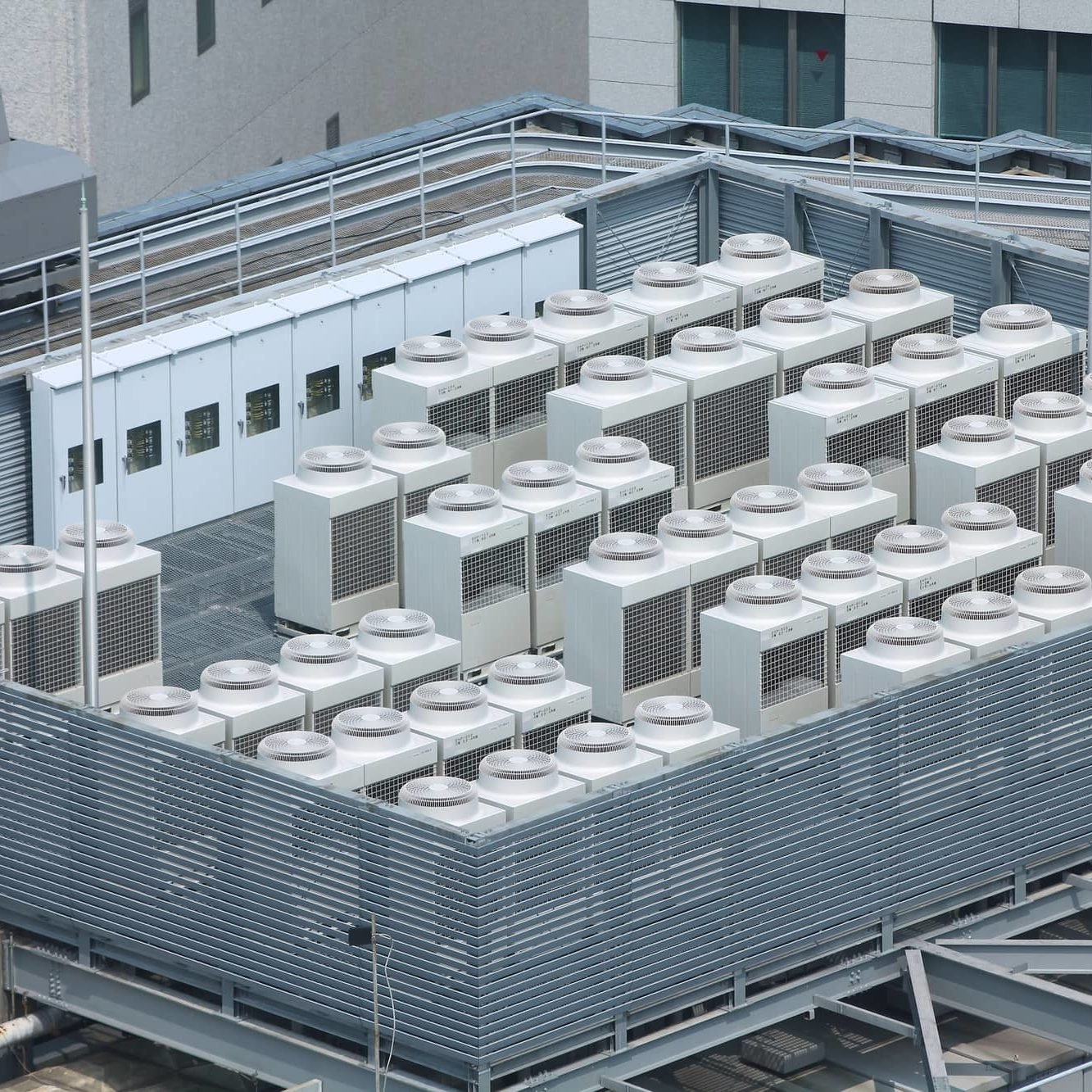 Exhaust vents of industrial air conditioning and ventilation units. Skyscraper roof top in Kobe, Japan.