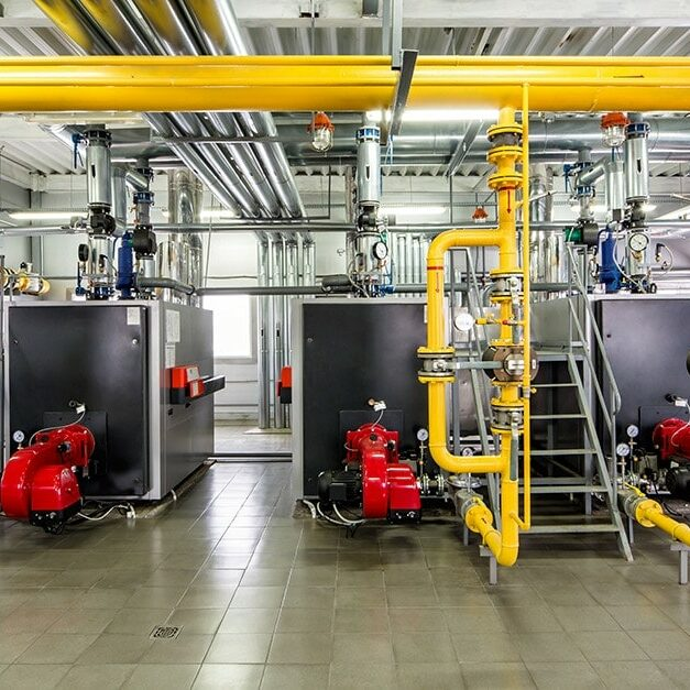 the-interior-of-gas-boiler-with-three-boilers